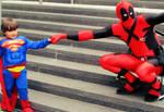 Deadpool fistbumps Superman