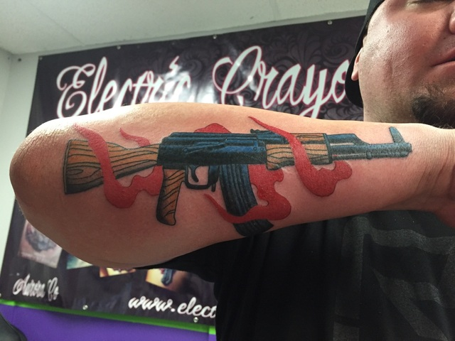 Ak gun tattoo by michaelpipertattoo on deviantart for Alaska tattoo shops