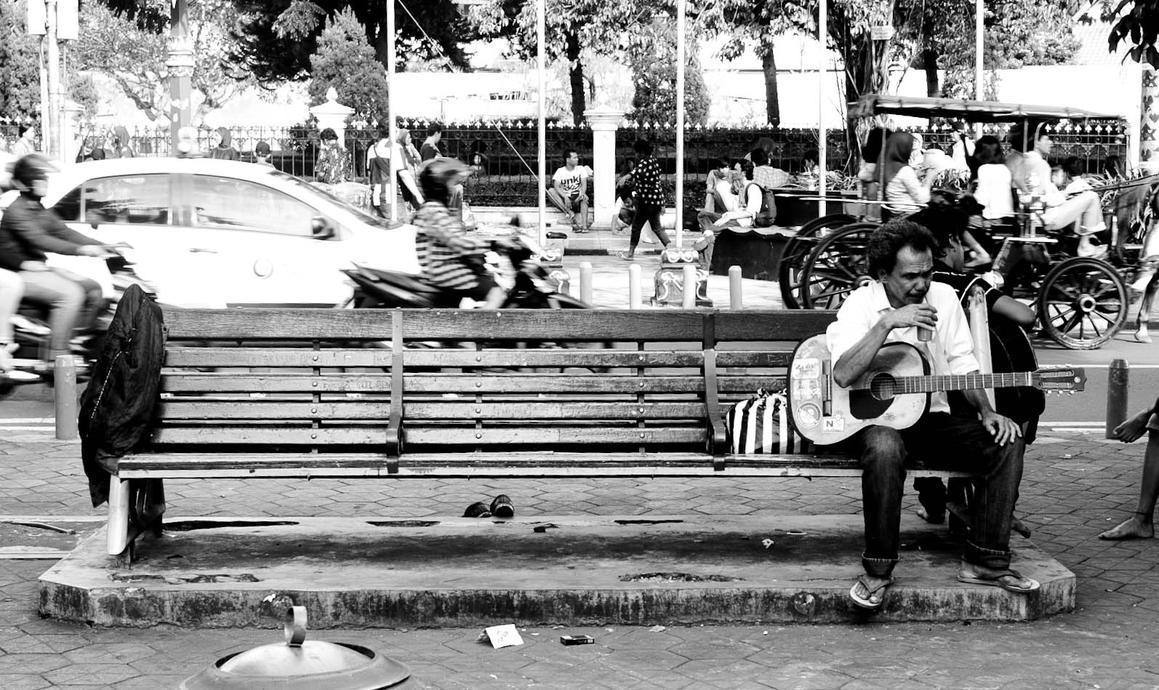 street busker resting by fantanicity