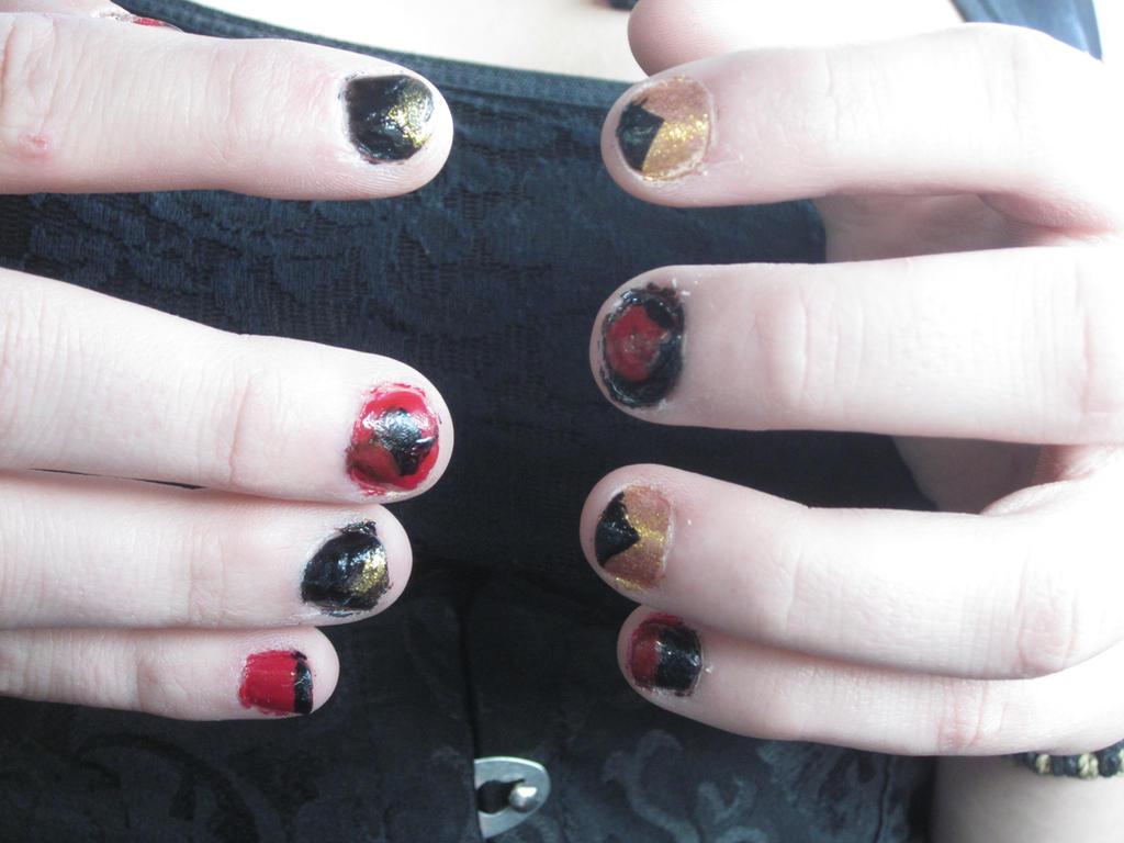 Umbreon/Harley Quin nail art by tay-bear