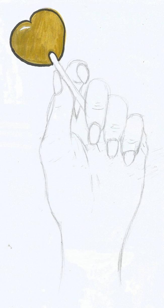 Hand holding a heart lollipop by birdandarose