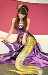 A golden naga in purple