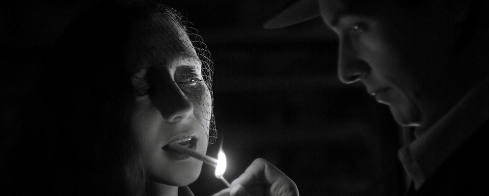 Noir: Light, madame?
