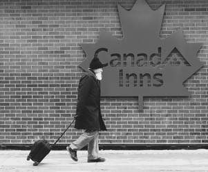 Old Man With Beard Walking By Canad Inns Sign by daveshaver