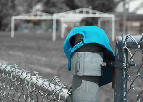 Childs Cap Left In Playground