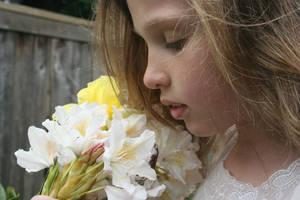 Girl Smelling Flowers 1 by rachellcoe