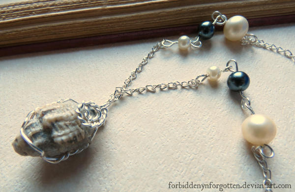 Wire Wrapped Gastropod Fossil Necklace by Forbiddenynforgotten