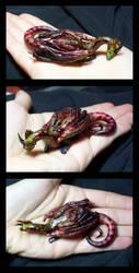 green headed pebble dragon by hibbary