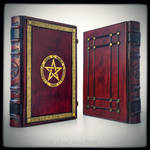 The Great Grimoire in bloody red leather...