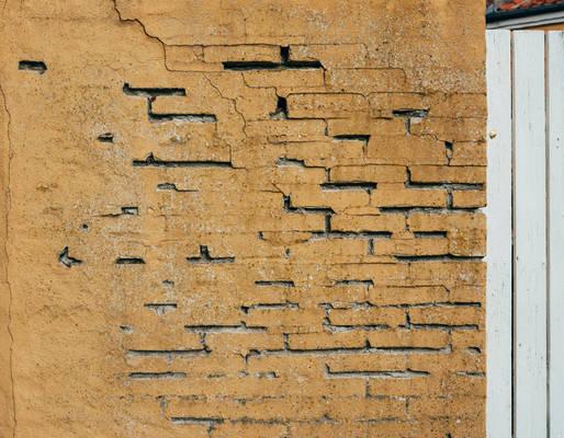 Stock - Old Painted Broken Brick Wall