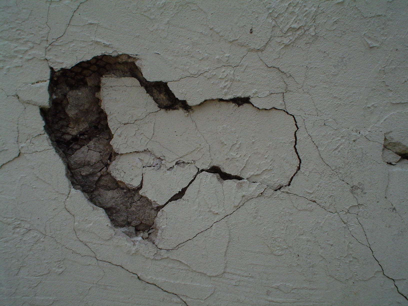 Hole Wall Hole in wall stock by