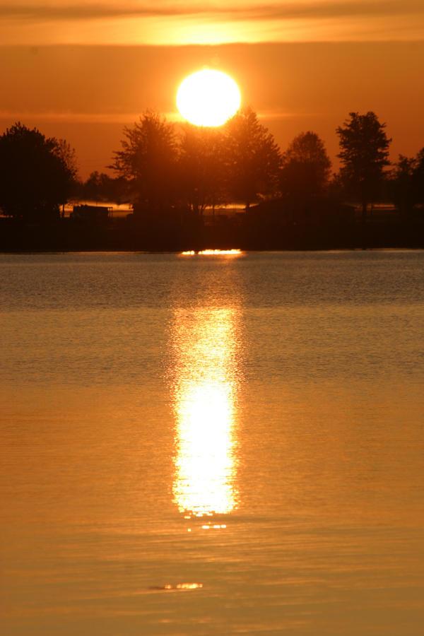 Sunrise on Chaumont Bay by Deidreofthesorrows