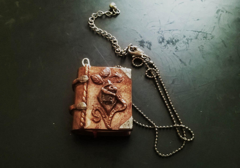 Old Book with a crystal pendant. by soophieO