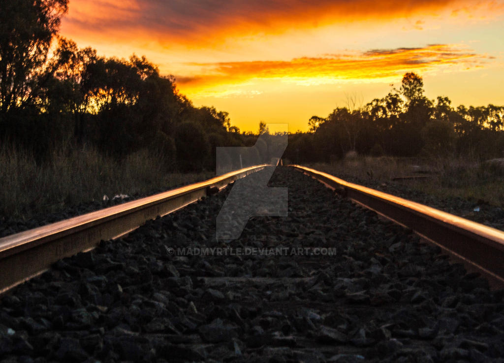 sunset on the tracks by madmyrtle