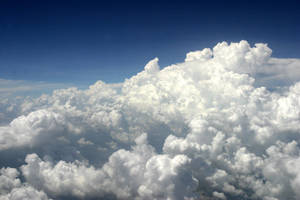 Top of Clouds:view from plane: by Della-Stock