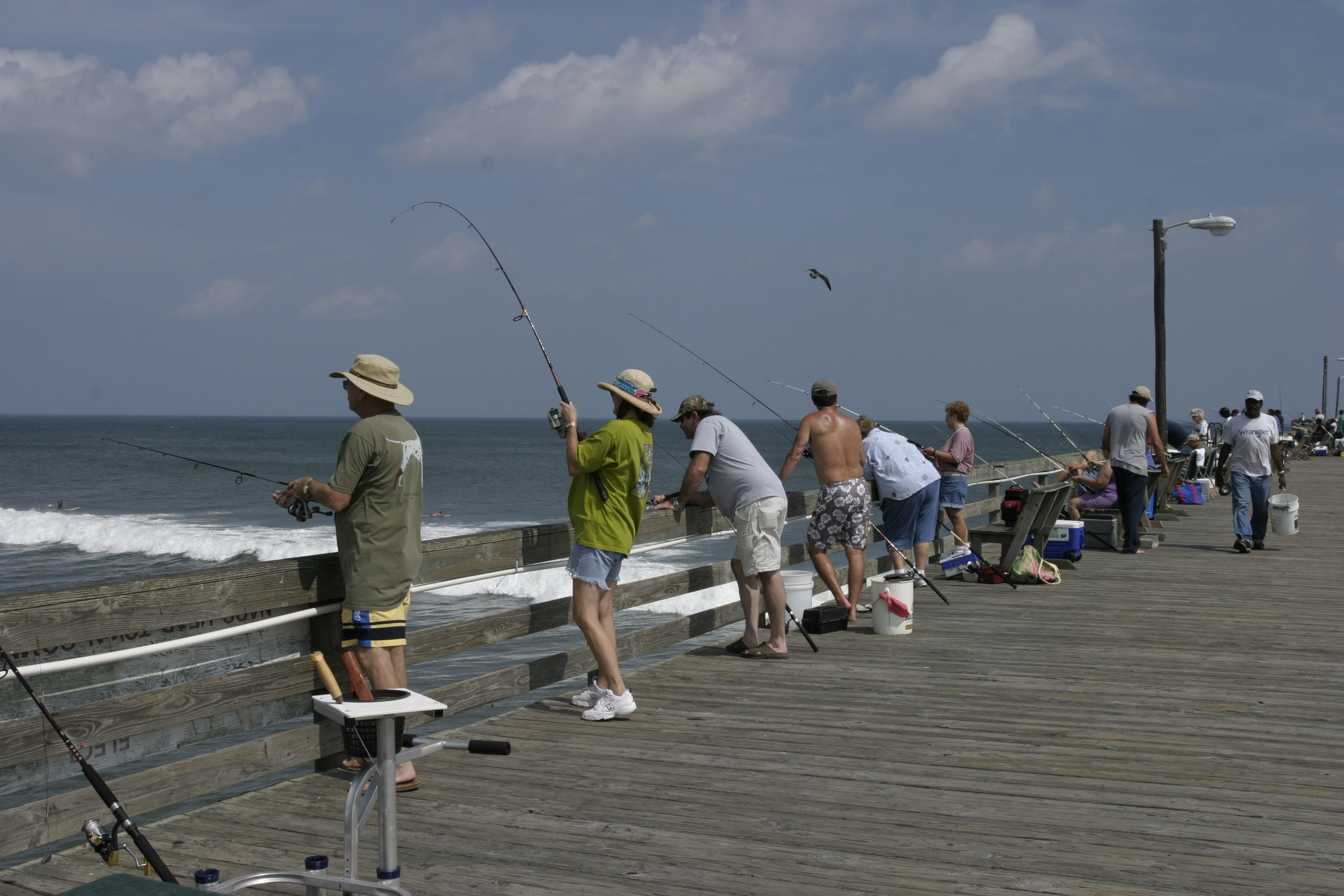 People fishing from pier by della stock on deviantart for Videos of people fishing