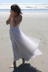 Woman crying at the beach by CathleenTarawhiti