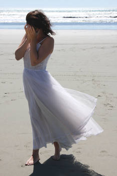 Woman crying at the beach