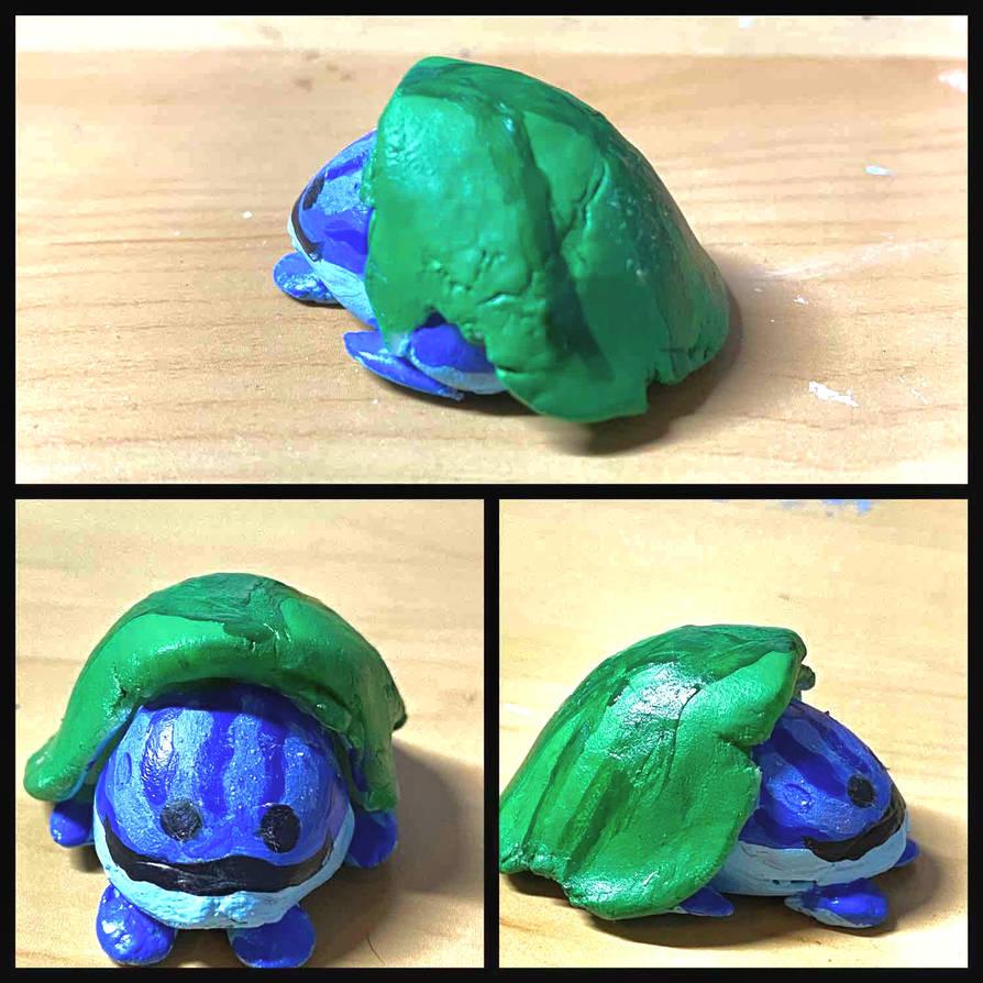 Frog Under a Leaf