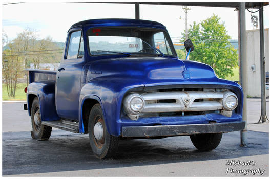 An Old Ford Truck With a Bad Paint Job