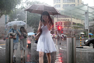 Lady in White in Rain