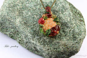 Floating Lotus Necklace on a stone by Tuile-jewellery
