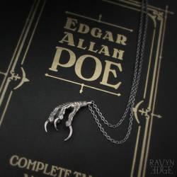 Raven Claw Talisman on Edgar Allan Poe book
