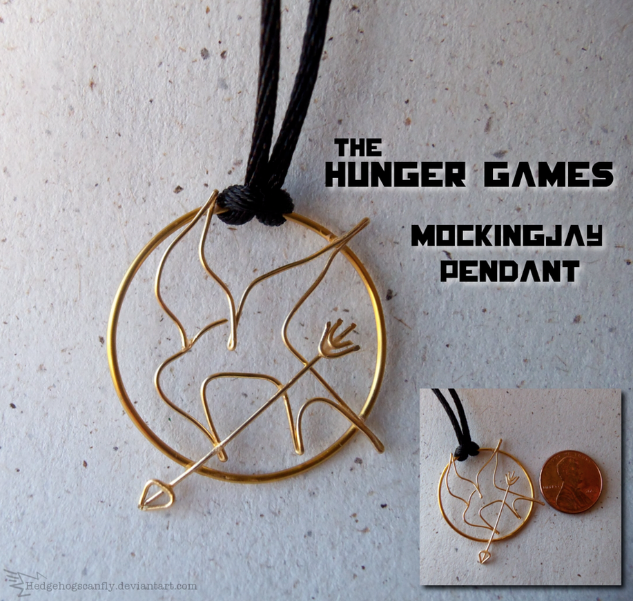 Hunger games mockingjay pendant by hedgehogscanfly on deviantart hunger games mockingjay pendant by hedgehogscanfly aloadofball Images