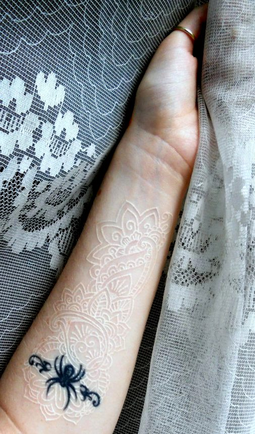 White ink, lace tattoo.