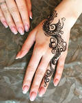 Simple mehndi design for back of the hand