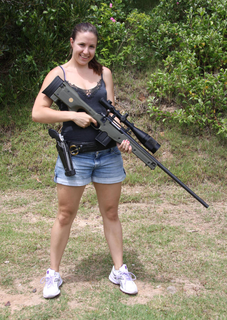 Sexy Girl with Guns standing by nedg67