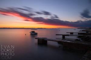 Autumn sunset on Adriatic coast by ivancoric
