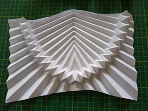 Parabolic flat-folding corrugation