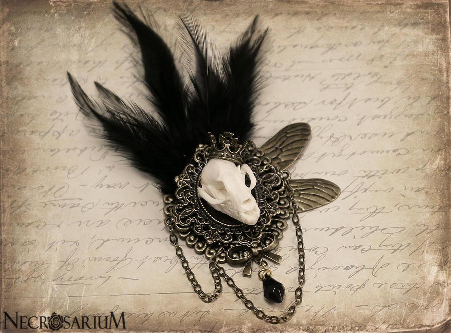 http://fc04.deviantart.net/fs71/i/2012/288/7/1/feathered_bat_skull_brooch_by_necrosarium-d5hy01w.jpg