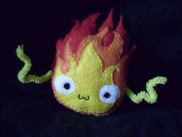HOWLS MOVING CASTLE:. calcifer by ruby-misted-eyes