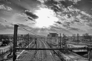 0337 Dramatic sky over the railroad station by RealMantis
