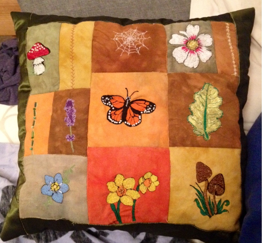 Woodland themed patchwork cushion by CozzaCake