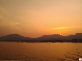 Red dusk from the Miyajima ferry by kawano-katsuhito