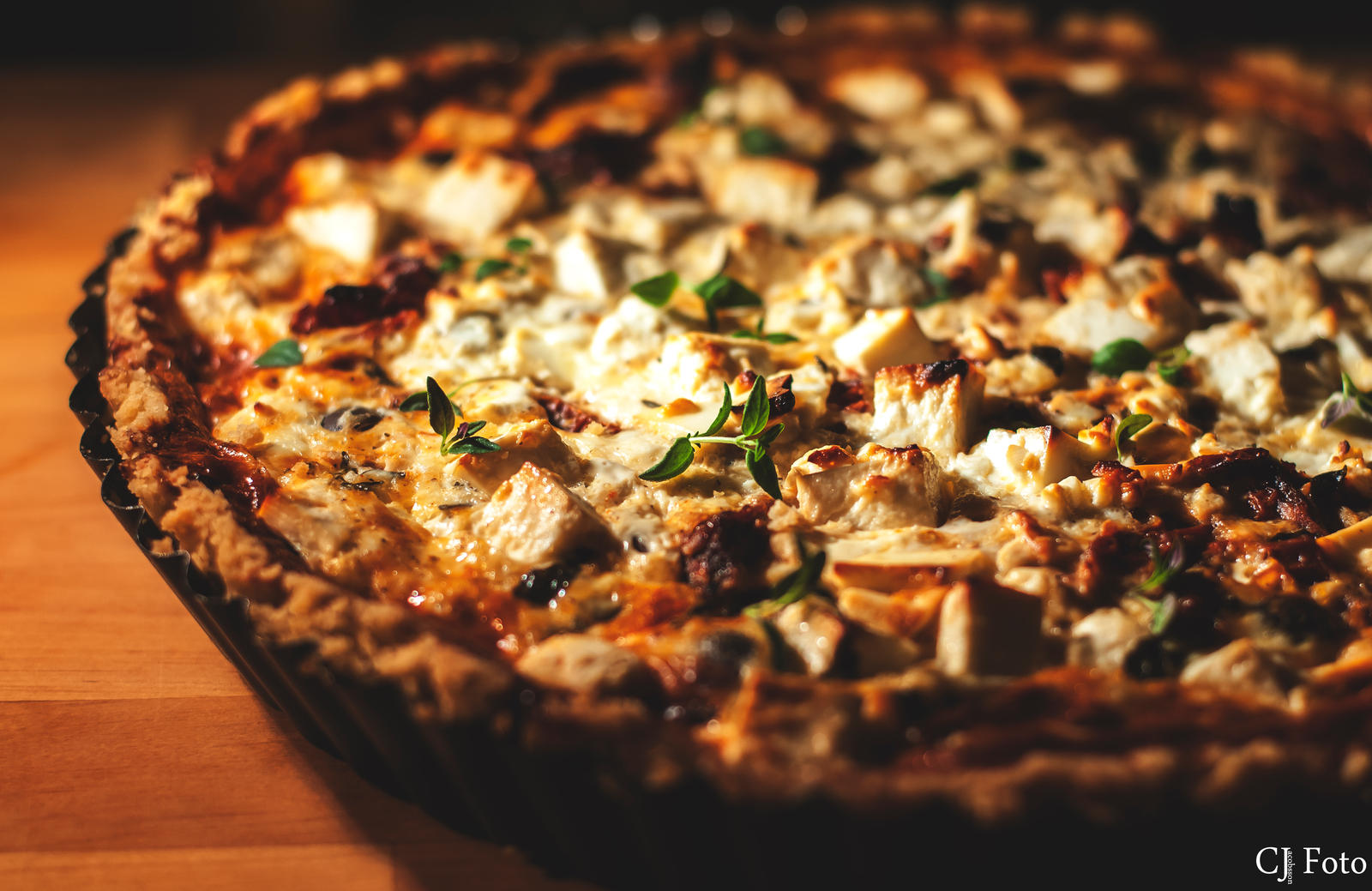 Pie with feta cheese and sundried tomatoes. by CJacobssonFoto