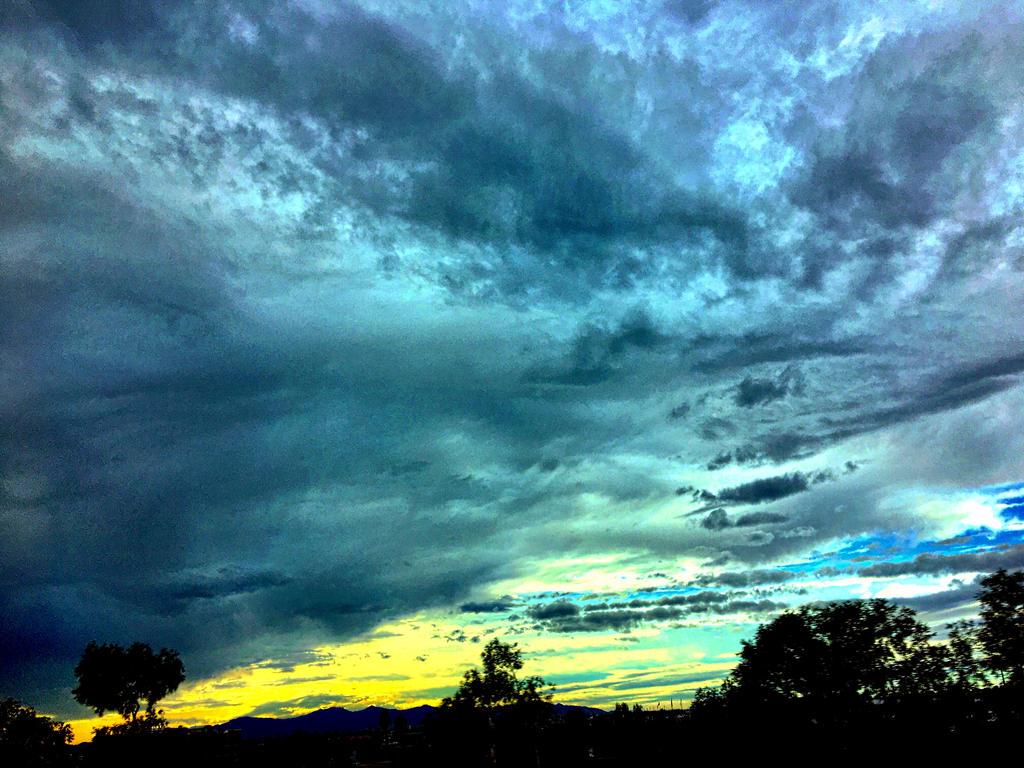 Stormy sun sets by RubyHalo-RavenWings