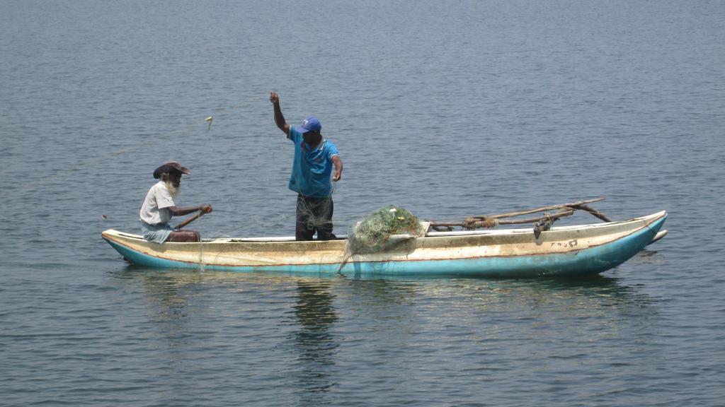 Fishing at Parakrama Samudra by aliasjjj