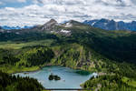 Snowy peaks lead to luscious lakes