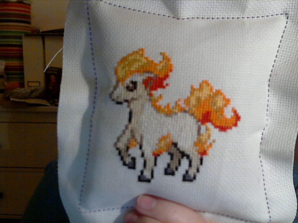 Ponyta pillow by Clairtjow