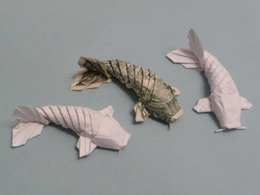 The way this dollar bill origami koi fish's eyes perfectly line up ... | 675x900