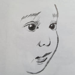 5 minute sketch of a small childs face.