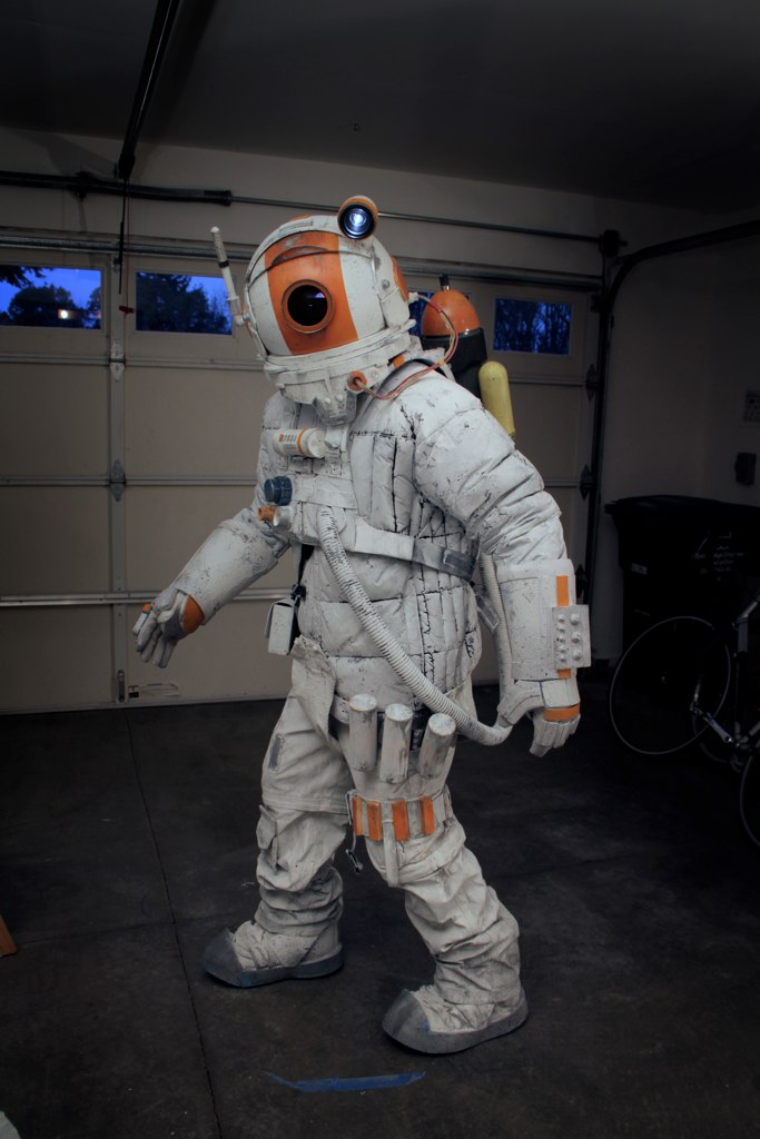 an astronaut in a space suit is motionless in outer space - photo #11
