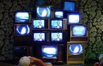 wall of vintage tvs