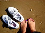 Tired feet on the shore
