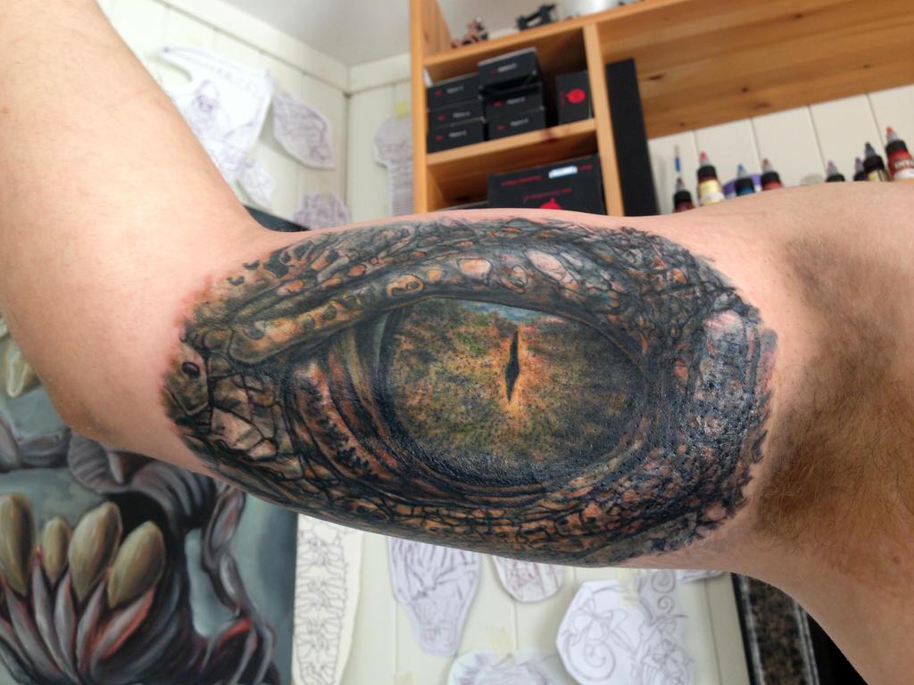 Crocodile eye tattoo