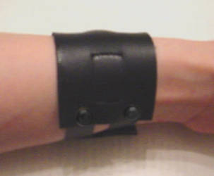 Simple Movie Lara Croft wrist band commission! by pbbunnybear